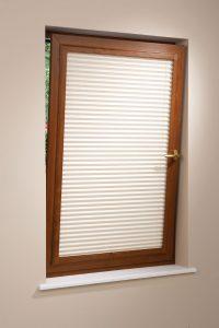 Closed oak frame pleated blind