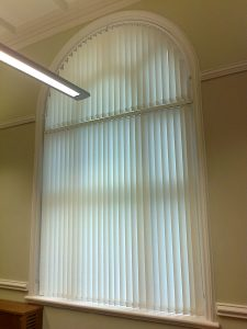 Vertical blinds in arched window
